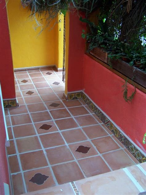 inserts into saltillo floor tile and mexican decorative