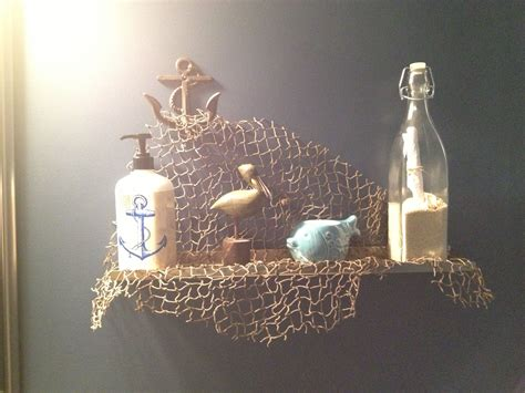 cute shelf decor   nautical bathroom