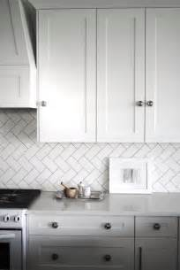 White Kitchen Backsplash Tile Remodeling Subway Tiles Backsplash White Tile Pattern Glossary Laid In A Herringbone Pattern