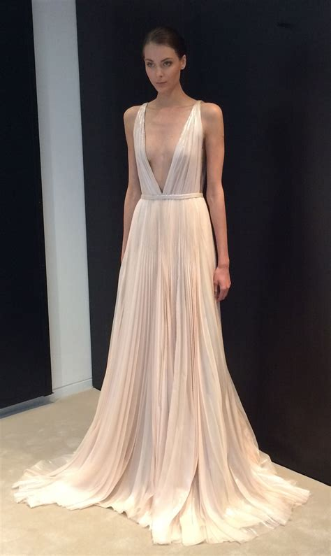 stunning blush pink deep  neck wedding dress spotted