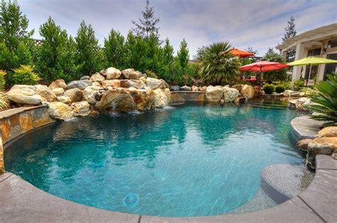Backyard Pool Luxury With A Hot Tub