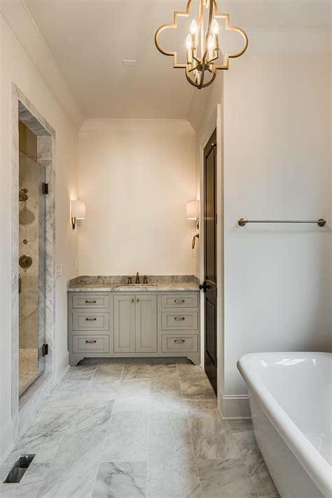 gray washstand  quatrefoil chandelier transitional