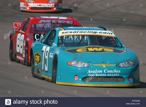 V8 Nascar Type Stock Cars Racing On A Banked Oval Circuit