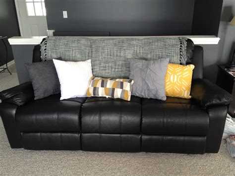 black leather sofa pillows lighten up a black leather couch with bright pillows and a