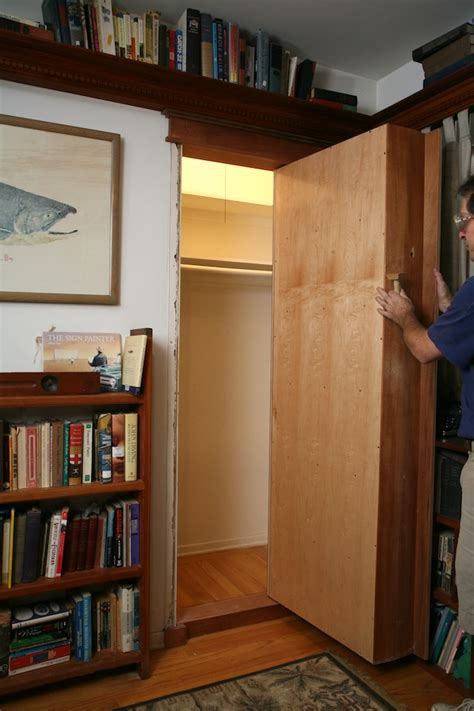 How To Build A Bookcase Door by Pivot Bookcase Installation Thisiscarpentry