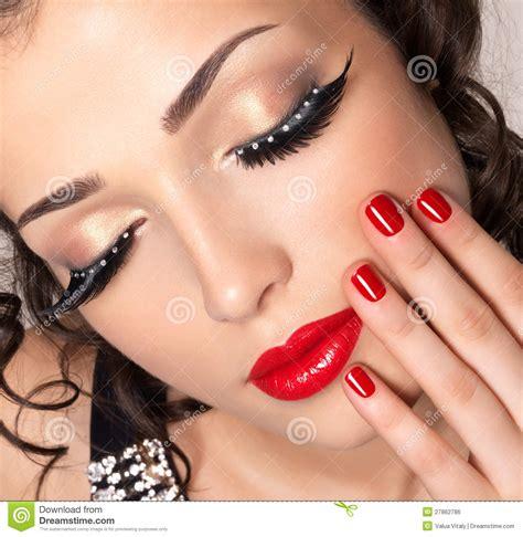 model  red nails lips  creative eye makeup royalty  stock image image