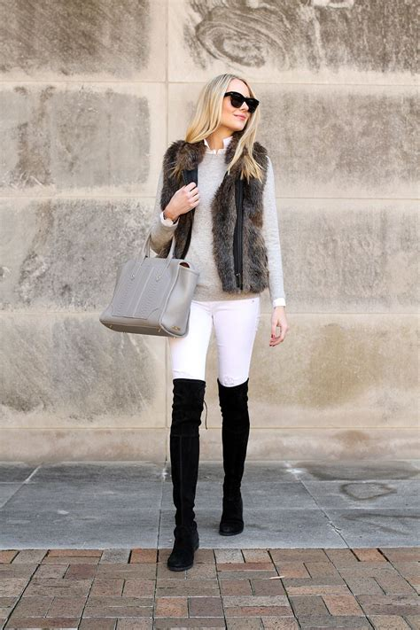 Fashion-jackson-faux-fur-vest-white-skinny-jeans-stuart-weitzman-black-lowland-over-the-knee ...
