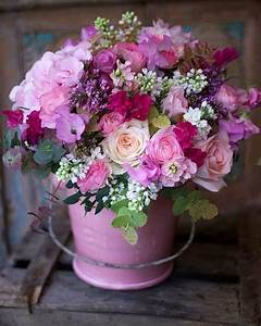 Floral Arrangement with pink and purple flowers in pink ...