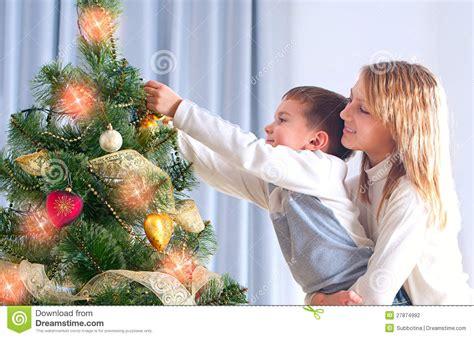 childrens christmas tree decorations decorating christmas tree stock photo image 27874992 5216