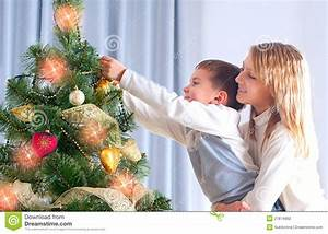 Kids Decorating Christmas Tree Stock Photo - Image: 27874992