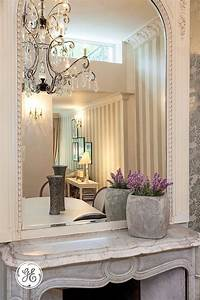 A, Large, Entryway, Mirror, Amplifies, The, Effect, Of, Lighting