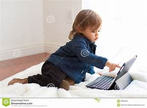 Toddler Girl Plays With Ipad Notebook Stock Photography