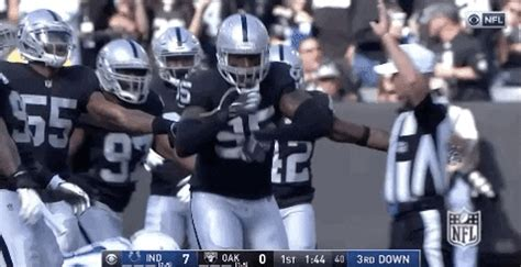oakland raiders dance gif  nfl find share  giphy