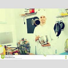 Chef Man Cooking In The Kitchen Stock Photo