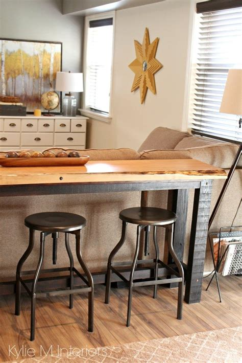 decorating idea for family or media room live edge wood console table with stools behind the
