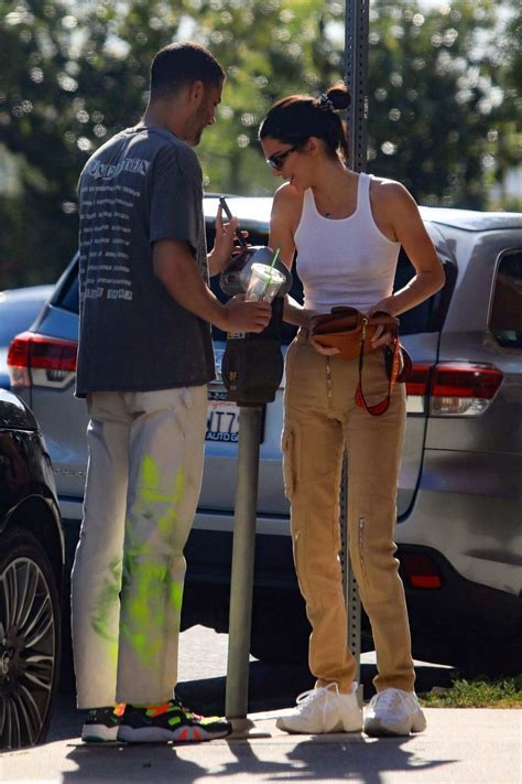 kendall jenner wears a white tank top and cargo pants ...