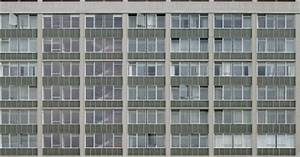 Office block building with grey panels and windows ...