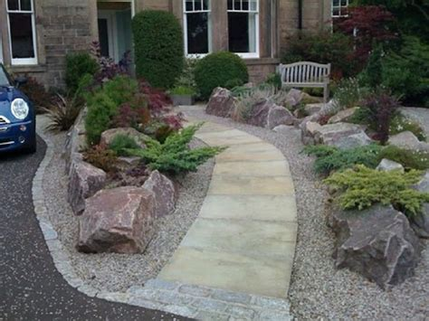 simple rock garden with decorative flower bed driveway