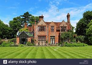 English Rural Manor House and garden with striped lawn ...