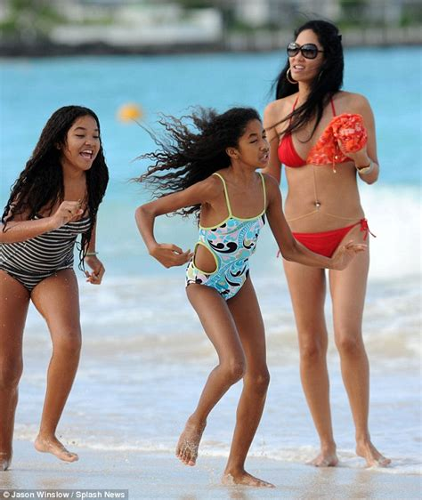 old time christmas decorating kimora lee simmons shows off her toned beach body in lemon
