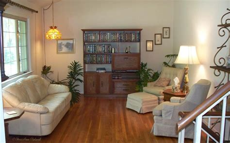 Living Room Without Rugs by Removing Area Rugs Makes A Room Look Larger