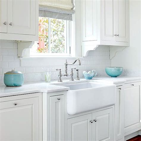 white kitchen with colorful accents farmhouse sink ideas subway tile backsplash turquoise 1833