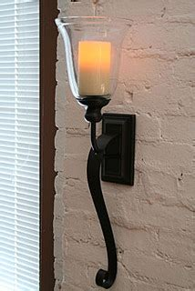 battery powered wall sconce rubbed bronze battery operated iron scroll sconce