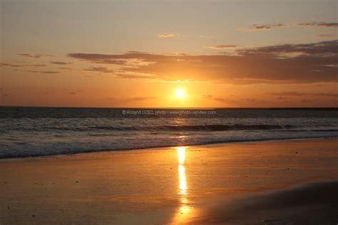 modele exposition cuisine photo coucher de soleil sur la plage photo vendée