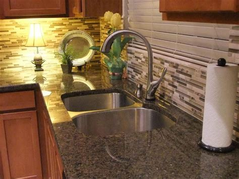 updating tropical brown granite counters with travertine