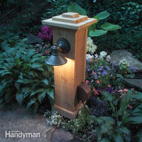 outdoor l post with outlet how to install outdoor lighting and outlet family handyman