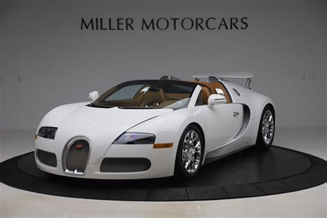 An engineering masterpiece that easily belongs in the car collection of any extremely wealthy automotive connoisseur. Pre-Owned 2011 Bugatti Veyron 16.4 Grand Sport For Sale () | Miller Motorcars Stock #7809