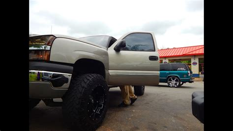 lifted chevy silverado   tires screaming  street