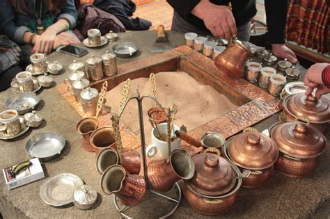 Turkish sand coffee requires many of the same tools that regular turkish coffee requires, namely a pot with a wide base, a narrow mouth, a long handle, and one or two spouts to use in pouring. Turkish coffee cooked on hot sands... | Travel | Pinterest | Italia, Turkish coffee and The o'jays