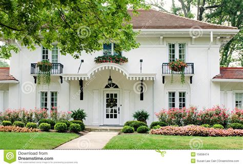 white house with pink flowers stock photo image 15658474
