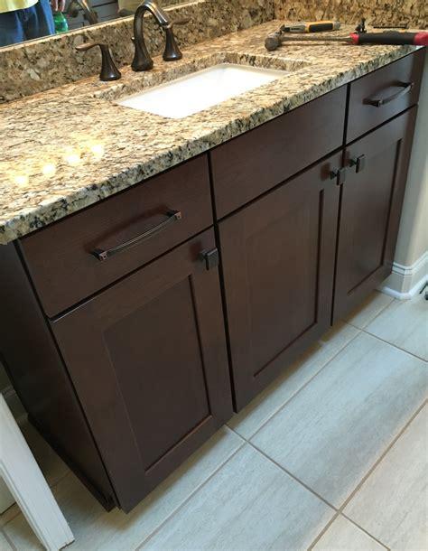 elegant raised master bathroom vanity  cherry cabinets