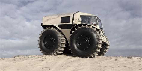 sherp atv   amphibious vehicle  plowing