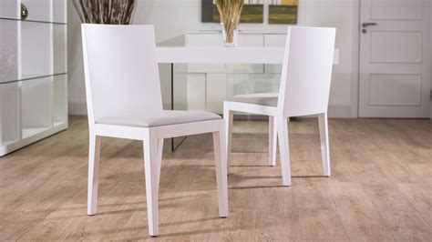 modern white dining chairs with floor protectors