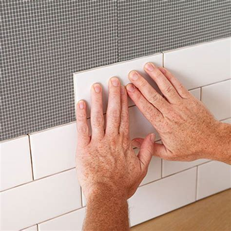 how to put up tile backsplash in kitchen 25 best ideas about stick on tiles on wood 9820