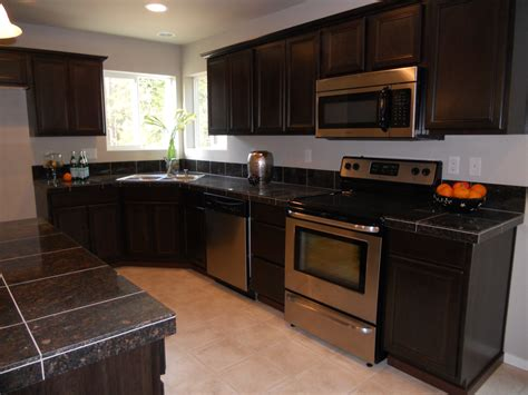 brown kitchen design ideas brown kitchen cabinets with black granite www 4938