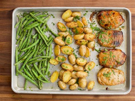 The layers of flavor or out of this world and its easier than you think! Ranch Pork Chop Sheet Pan Supper Recipe   Ree Drummond ...