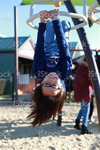 Girl, Upside, Down, On, The, Jungle, Gym, Stock, Photo