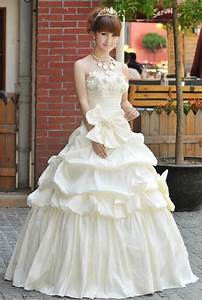 Why do so many japanese brides rent their wedding dresses for Wedding dress rental tokyo