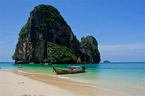 Phra Nang Beach | A boat sits at anchor in front of one of ...