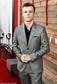 Australian actor Nicholas Hamilton looks stylish in a grey ...