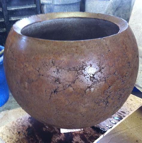 hand  handmade stained concrete planter  concrete