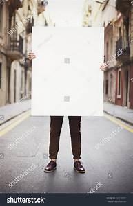 Man Holding Blank Poster Stock Photo 180748991 : Shutterstock