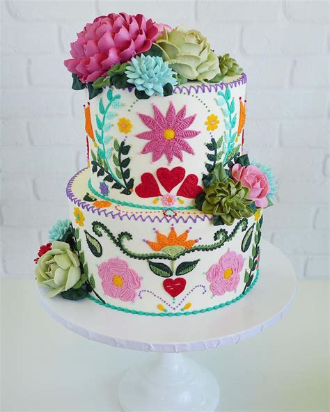 cake art features realistic flowers   buttercream