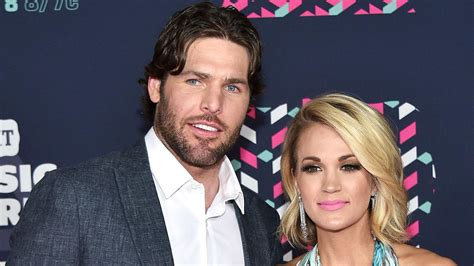 carrie underwood reacts  husband mike fisher retiring