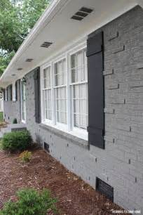 Painted Brick House with Batten Board Shutters