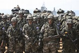 File:South Korean and Thai marines wait to be debriefed after completion of a simulated beach assault during a joint amphibious landing ...